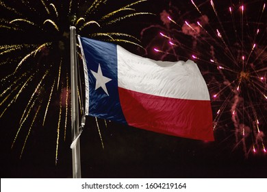 Texas flag blowing in the wind at night