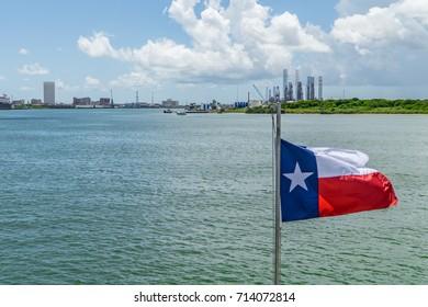 Texas flag over Galveston Bay