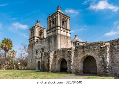 Texas Mission Concepcion side view with arches along the fortress walls church dome in the background