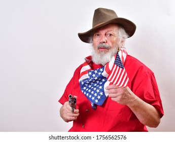 Texas rancher wearing a patriotic bandana and ready to defend his propery.Old man with a floppy western hat and a six shooter.