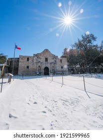 Texas Snow Winter freezing weather at the Alamo in San Antonio. Inclement weather snow storm blizzard in the south United States. Effects of Climate Change.