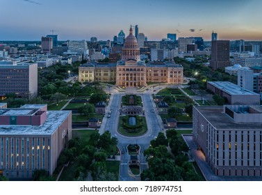 The Texas State Capitol Building in Austin, Texas featuring the Austin skyline during twilight