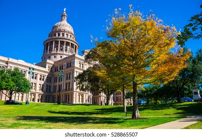 Texas State Capitol building during Fall Colors Autumn Season with Blue Sky Sunny gorgeous day in November Central Texas bliss Austin Texas USA