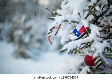 Texas state flag. Christmas background outdoor. Christmas tree covered with snow and decorations and Texas flag. New Year / Christmas holiday greeting card.