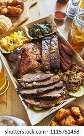 texas style bbq tray with smoked brisket, st louis ribs, pulled pork, chicken, hot links, and sides