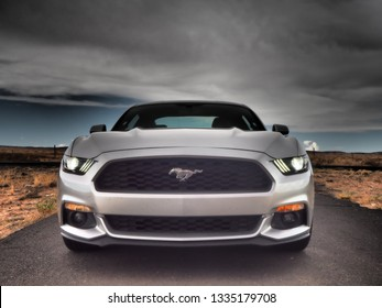 TEXAS, USA - JULY 23, 2018: Dramatic shot of silver Ford Mustang in Texas desert.