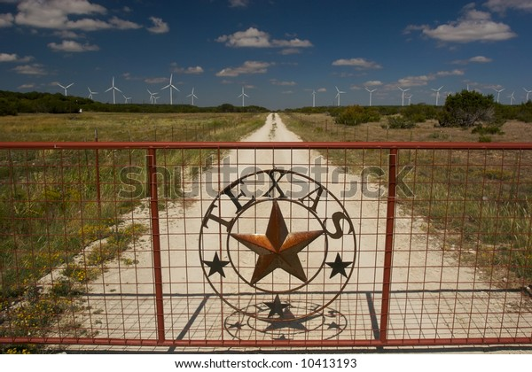 TEXAS WIND FARMS with rusted gate