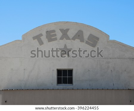 Texas writing and star on building