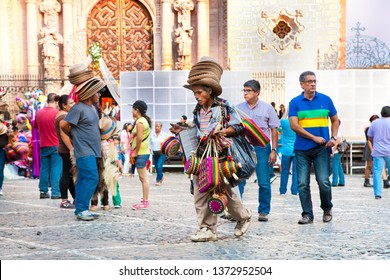 Texco, Mexico- Nov 21, 2015; Hat seller at main plaza in the historic center of Texco traditional colonial city in Mexico, Latin America.