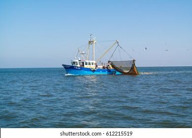 TEXEL, NETHERLANDS - SEP 14, 2016: Commercial outrigger trawler shrimp fishing on Waddensea, Netherlands