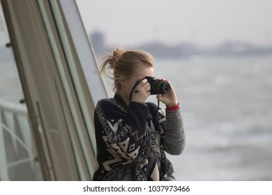 TEXEL WADDENSEA, THE NETHERLANDS - MAART 1 2018 : Photographing lady on the boat from Den Helder to Texel on Maart 1 ,2018 in Texel.