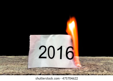 "Text ""2016"" on burning paper"