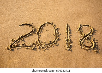 Text 2018 on a beach sand. Concept New Year 2018 is coming soon