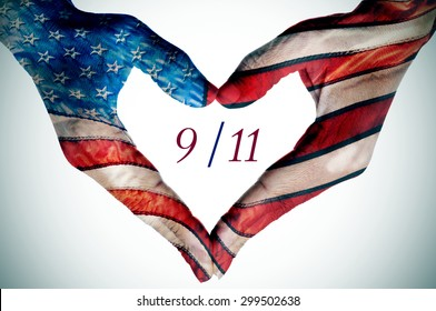 the text 9/11 written in the blank space of a heart sign made with the hands of a young woman patterned as the flag of the United States