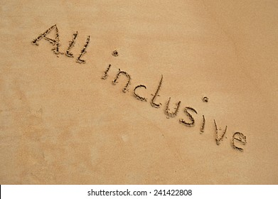 """The text """"all inclusive"""" written in the sand at the beach."""