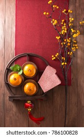 Text appear in image: Prosperity. Chinese new year objects on rustic wooden background.