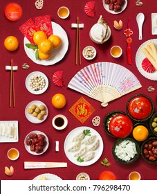 Text appear in image: Prosperity, Wealth. Flay lay Chinese new year food and drink, related objects on red background.