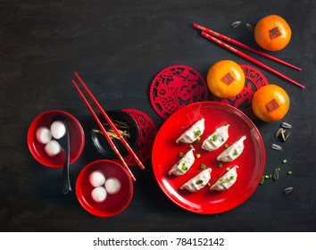 Text appear in image: Spring, Lucky and Prosperity. Flat lay Chinese new year food and drink still life.