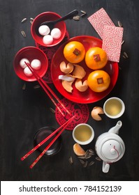 Text appear in image: Spring and prosperity. Flat lay Chinese new year food and drink still life.