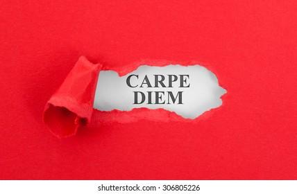 Text appearing behind torn red envelop - Carpe diem