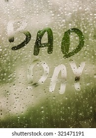 """Text """"BAD DAY"""" written in a crystal with many drops."""