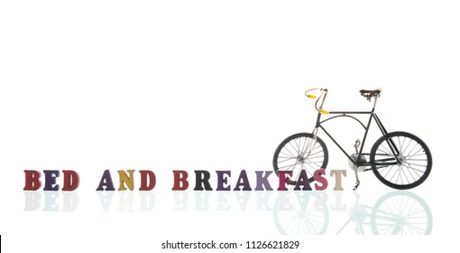 Text bed and breakfast with bike isolated over white background