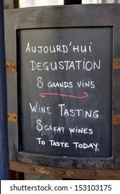 Text board with advertisement for wine tasting at a French restaurant
