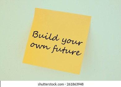Text build your own future on the short note texture background