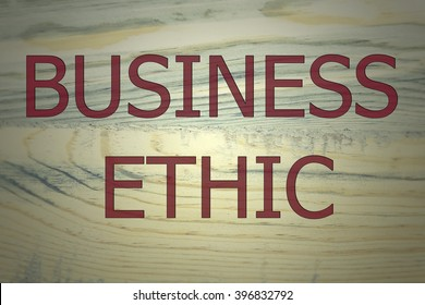 The text business ethic on brown wooden. wooden background