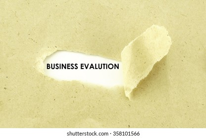 Text BUSINESS EVALUTION appearing behind torn light brown envelope