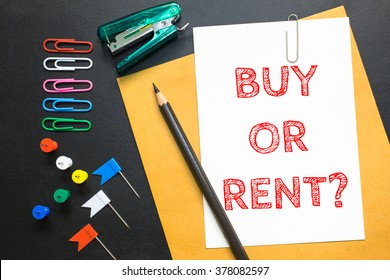 Text Buy or Rent on white paper background