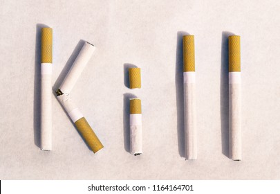 "Text from cigarettes ""KILL"""