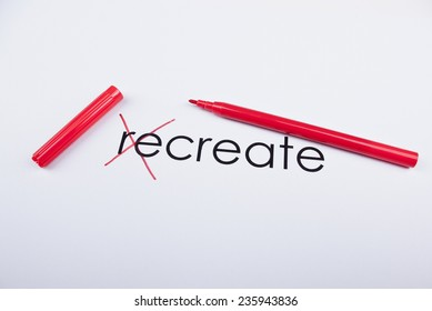 """Text Create written on paper letters """"re"""" are crossed out with red marker."""