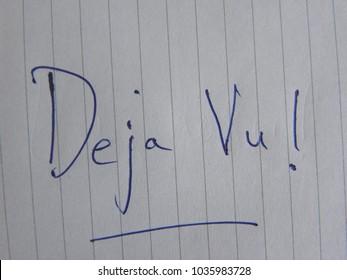 Text Deja Vu hand written by blue pen on notebook paper