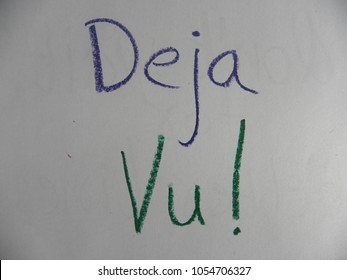 Text Deja Vu! hand written by colorful oil pastels on paper