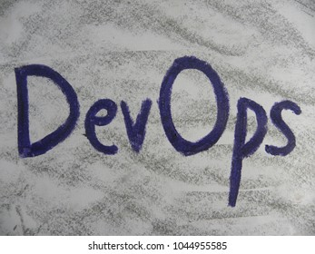 Text DevOps hand written by colorful oil pastels