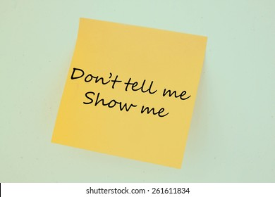 Text don't tell me show me on the short note texture background