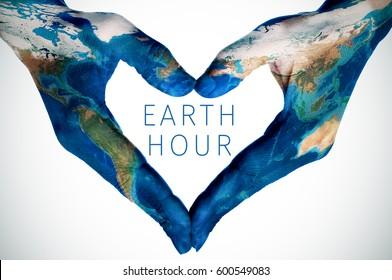 l'heure de terre du texte et les mains d'une jeune femme, modelée sur une carte du monde (meublée par la NASA), formant un coeur