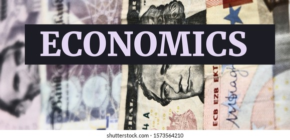 Text of economics. concept for economics, finance, international political economics, banking, exchange rate, business and economic topics. Dollar, Euro and Sterling banknotes background.