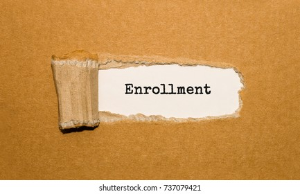 The text Enrollment appearing behind torn brown paper