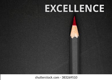 Text Excellence with pencil on black background