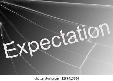 The text Expectation on the broken glass. Concept of mindless hopeless waiting Background