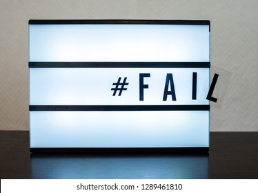 Text Fail and hashtag. Concept for error and falling. Illuminated message.