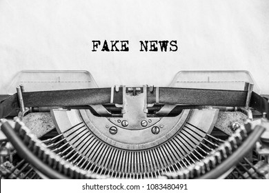 the text FAKE NEWS is typed on old paper by a vintage typewriter close-up.
