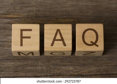 text FAQ on a wooden cubes