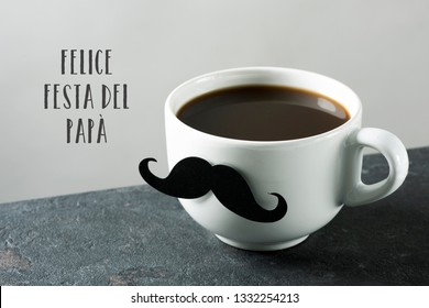 the text felice festa del papa, happy fathers day in italian. and a white ceramic cup with coffee, with a fake mustache attached to it