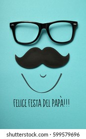 the text felice festa del papa, happy fathers day in italian, and a pair of eyeglasses and a mustache depicting a man face, on a blue background