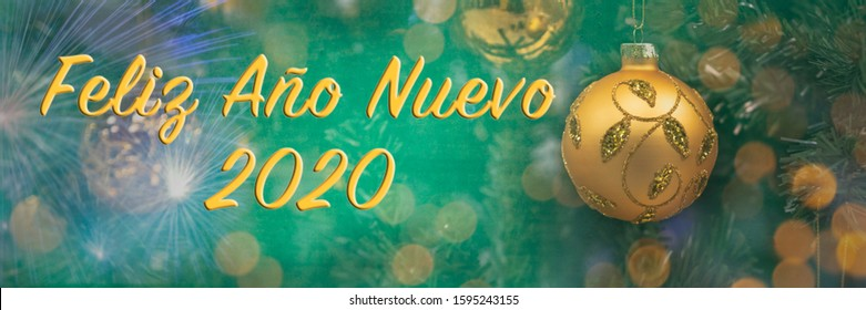 "Text ""Feliz Ano Nuevo"" means ""Happy New Year 2020"" in Spanish. Blurred background of decorated Christmas tree with big golden ball. Bokeh. Celebration. 1 January. Greeting postcard Spain. Header."