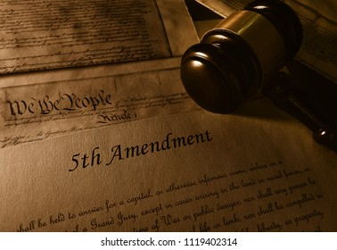 Text of the Fifth Amendment to the US Constitution and gavel