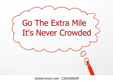 The text Go The Extra Mile It's Never Crowded
